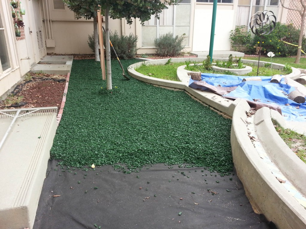 Playground Installation Services include adding safe play surface material